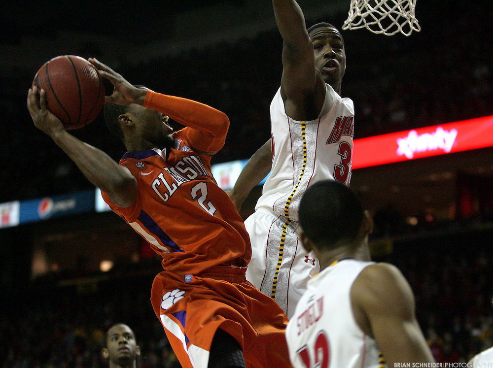 Jan 22, 2011; College Park, MD, USA; Clemson Tigers guard Demontez Stitt (2) attempts a layup against Maryland Terrapins forward Dino Gregory (33) during the second half at the Comcast Center. Mandatory Credit: Brian Schneider-www.ebrianschneider.com