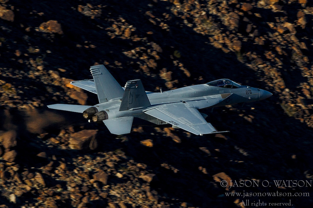 "US Navy Boeing F/A-18E Super Hornet NJ-276 from Strike Fighter Squadron 122 (VFA-122) the ""Flying Eagles"" flies through the Jedi Transition over Rainbow Valley, Death Valley National Park, California, United States of America"