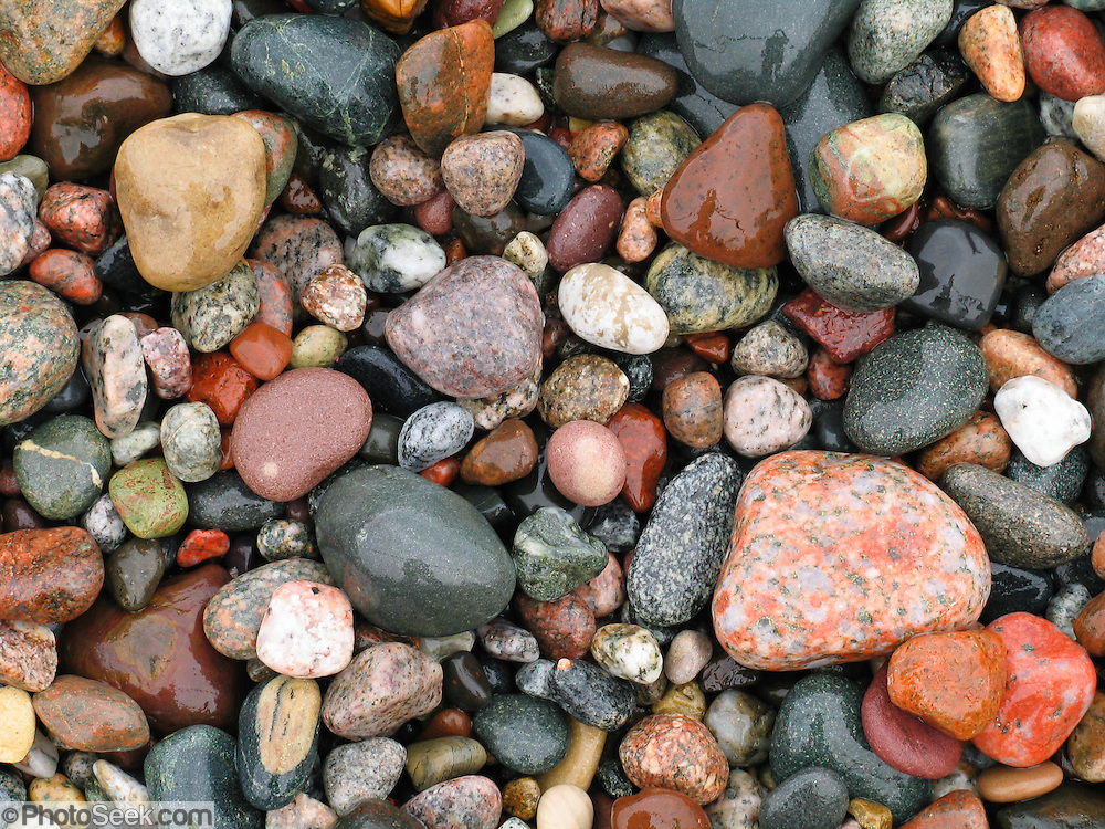 "Lake Michigan waves have tumbled and smoothed colorful pebbles into rounded shapes at Pictured Rocks National Lakeshore on the Upper Peninsula of Michigan, USA. The scenic park includes the hilly shoreline between Munising and Grand Marais, Michigan. Published in ""Light Travel: Photography on the Go"" by Tom Dempsey 2009, 2010."