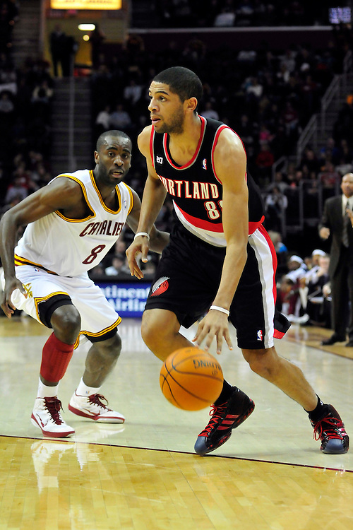 Feb. 5, 2011; Cleveland, OH, USA; Portland Trail Blazers small forward Nicolas Batum (88) drives past Cleveland Cavaliers guard Christian Eyenga (8) during the first quarter at Quicken Loans Arena. Mandatory Credit: Jason Miller-US PRESSWIRE