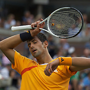 Novak Djokovic, Serbia, in action against Roger Federer, Switzerland, during  the US Open Tennis Tournament at Flushing Meadows, New York, USA, on Sunday, September 13, 2009. Photo Tim Clayton.