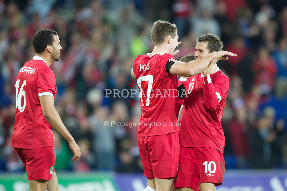 CARDIFF, WALES - Saturday, November 12, 2011: Wales' Sam Vokes celebrates scoring the fourth goal against Norway with team-mate and captain Aaron Ramsey during the international friendly match at the Cardiff City Stadium. (Pic by Vegard Grott/Propaganda)