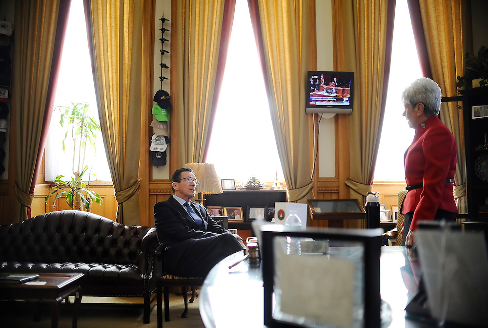 Connecticut Gov. Dannel P. Malloy, left, talks with Lt. Gov. Nancy Wyman, right, as they wait in her office for Wyman to be sworn in of a second term at the State Capital, Wednesday, Jan. 7, 2015, in Hartford, Conn.  (AP Photo/Jessica Hill)