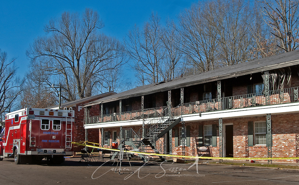 A firetruck is parked outside an apartment building at Academy Crossing in Starkville, Miss., where an early morning fire took the lives of nine people, including six children, Dec. 28, 2009. Oktibbeha County coroner Mike Hunt said the children ranged in age from four months to six years old. The cause of the fire is still under investigation. (Photo by Carmen K. Sisson/Cloudybright)