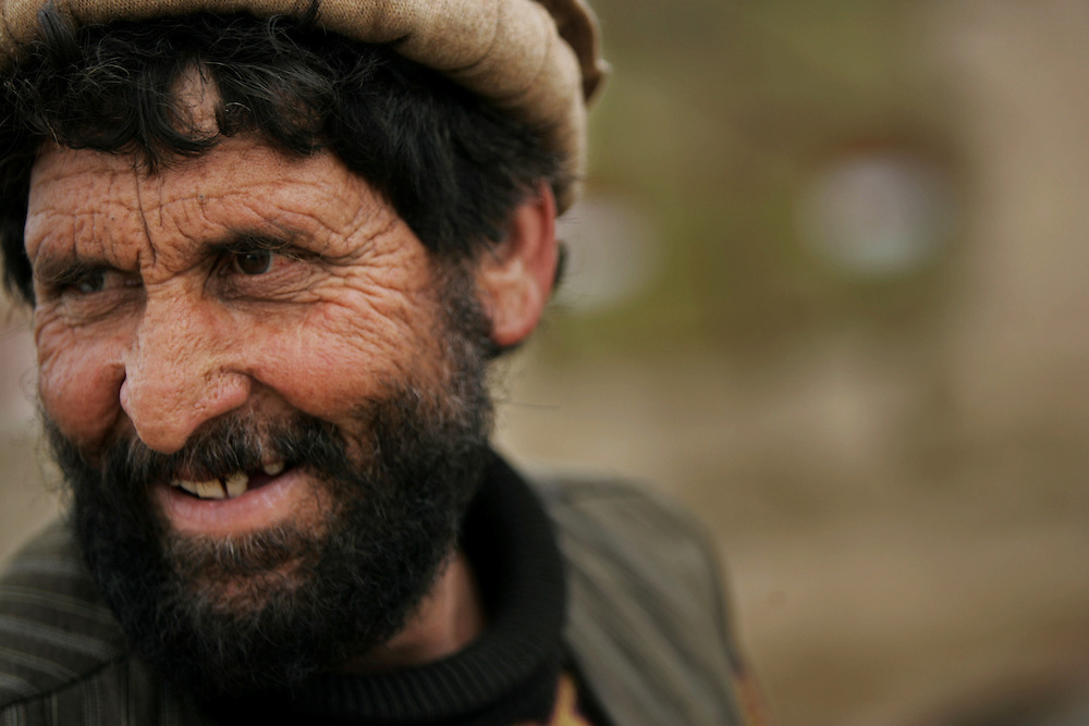 A bearded man sits in Qala-eQazi, Afghanistan.