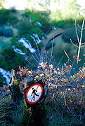 """No Hiking"" sign on edge of steep cliff, Plitvice National Park, Croatia"