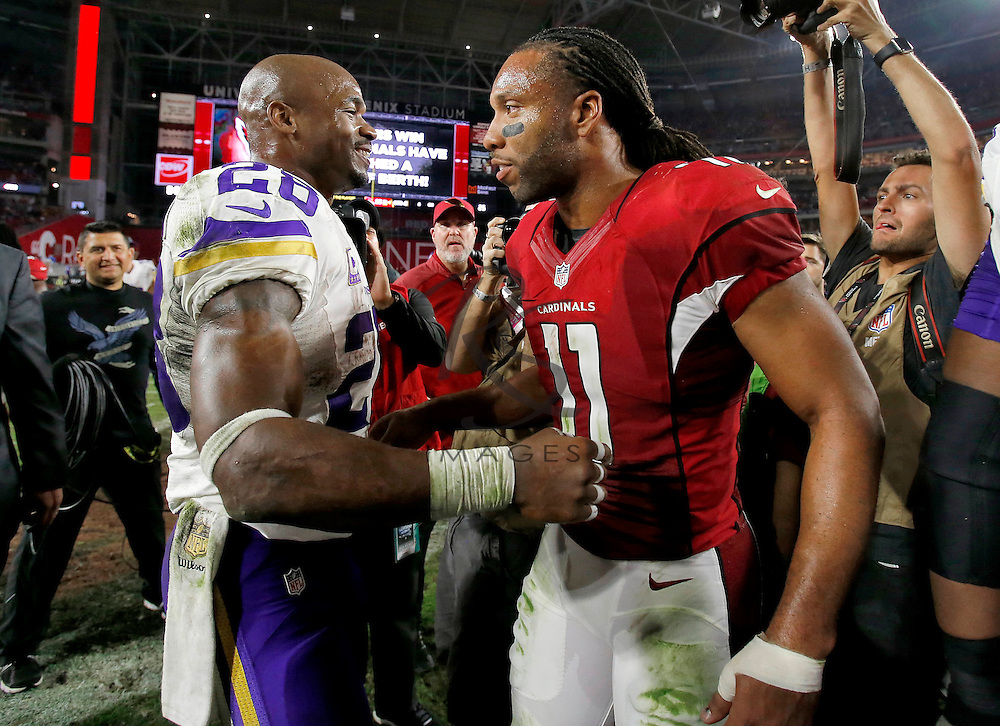 Arizona Cardinals wide receiver Larry Fitzgerald (11) and Minnesota Vikings running back Adrian Peterson (28) meet at mid field after an NFL football game, Thursday, Dec. 10, 2015, in Glendale, Ariz. The Cardinals won 23-20. (AP Photo/Rick Scuteri)