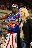 "04 May 2006: Kevin ""Special K"" Daley escorts Rene Legruc of Anchorage back to her seat after stealing her purse during the Harlem Globetrotters vs the New York Nationals at the Sulivan Arena in Anchorage Alaska during their 80th Anniversary World Tour.  This is the first time in 10 years that the Trotters have visited Alaska."