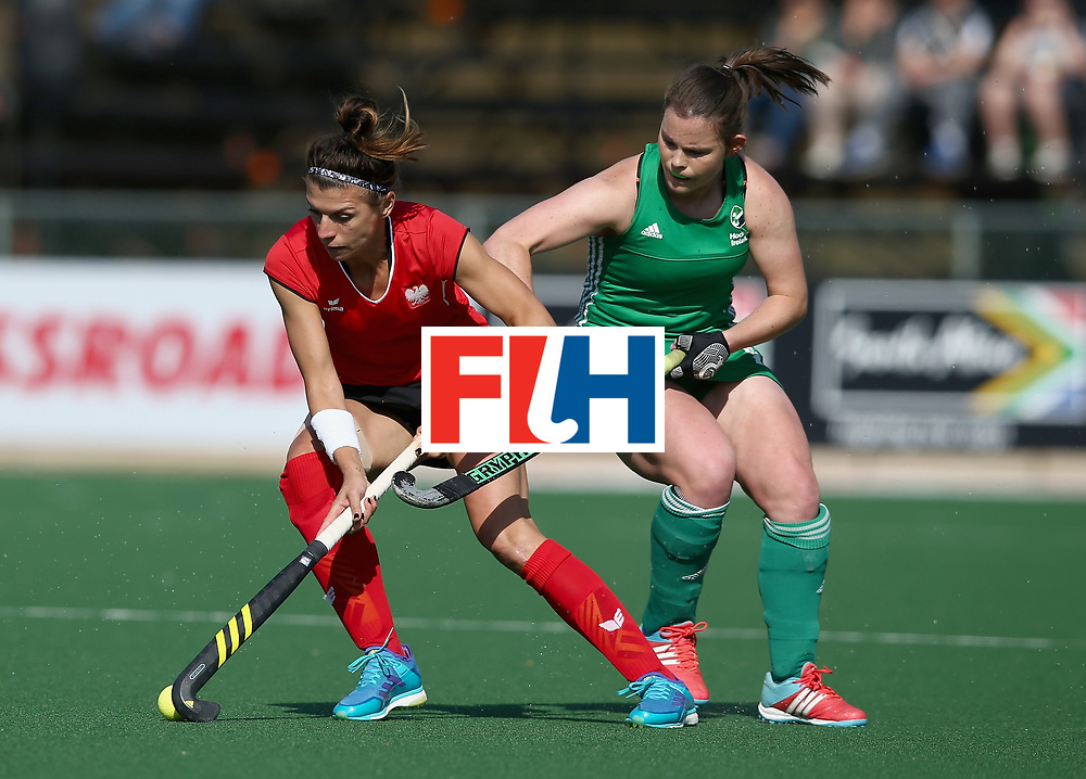 JOHANNESBURG, SOUTH AFRICA - JULY 12: Natalia Wisniewska of Poland and Lizzie Colvin of Ireland battle for possession during day 3 of the FIH Hockey World League Semi Finals Pool A match between Ireland and Poland at Wits University on July 12, 2017 in Johannesburg, South Africa. (Photo by Jan Kruger/Getty Images for FIH)