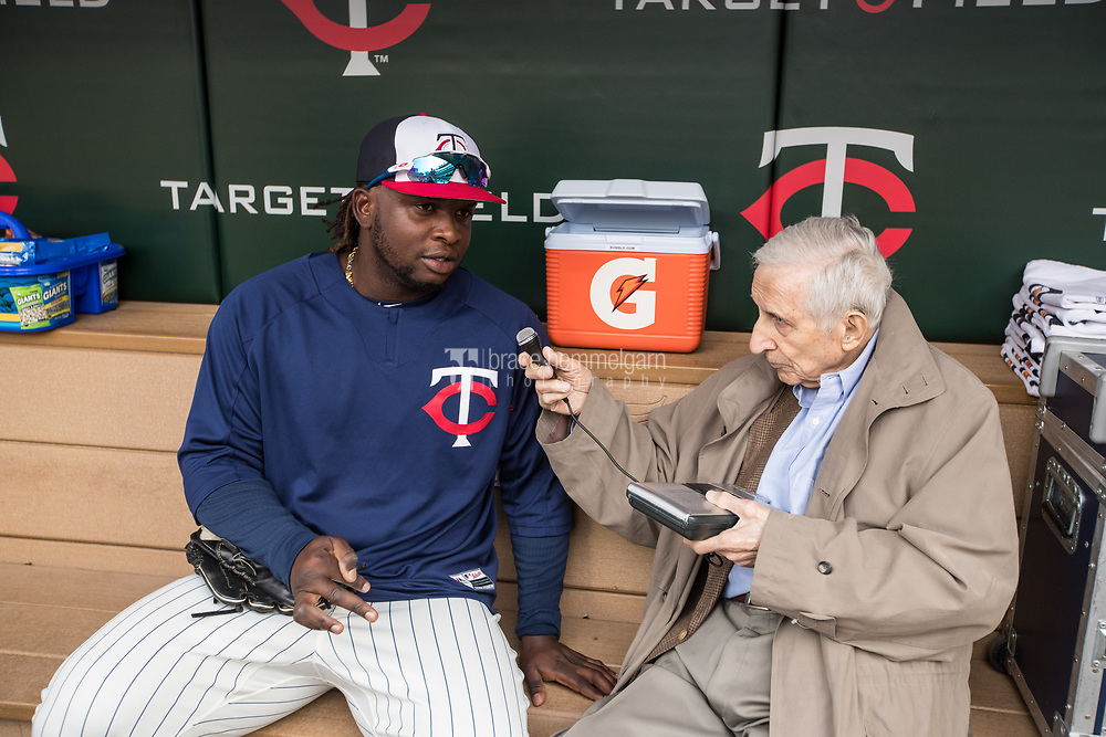 MINNEAPOLIS, MN- APRIL 5: Miguel Sano #22 of the Minnesota Twins talks with media personality Sid Hartman against the Kansas City Royals on April 5, 2017 at Target Field in Minneapolis, Minnesota. The Twins defeated the Royals 9-1. (Photo by Brace Hemmelgarn) *** Local Caption *** Sid Hartman;Miguel Sano