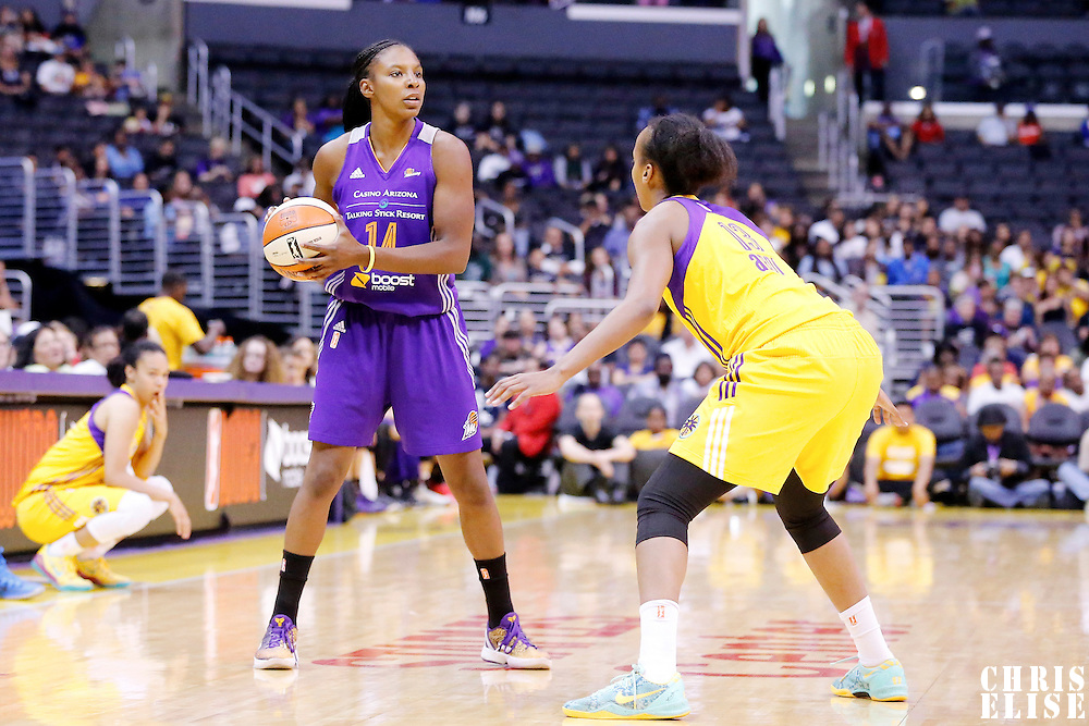 18 May 2014: Phoenix Mercury guard Eshaya Murphy (14) looks to pass the ball over Los Angeles Sparks forward Farhiya Abdi (13) during the Phoenix Mercury 74-69 victory over the Los Angeles Sparks, at the Staples Center, Los Angeles, California, USA.