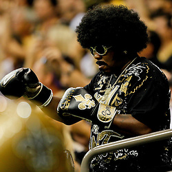 September 25, 2011; New Orleans, LA, USA; A New Orleans Saints fan in the stands during the fourth quarter against the Houston Texans at the Louisiana Superdome. The Saints defeated the Texans 40-33. Mandatory Credit: Derick E. Hingle