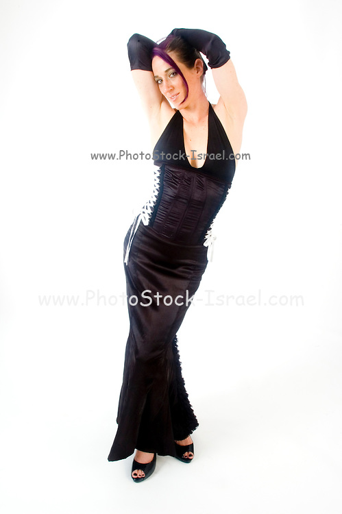 woman aged 30 in black top, long skirt and black gloves, on white background hands on head, Full frontal view, Model Released