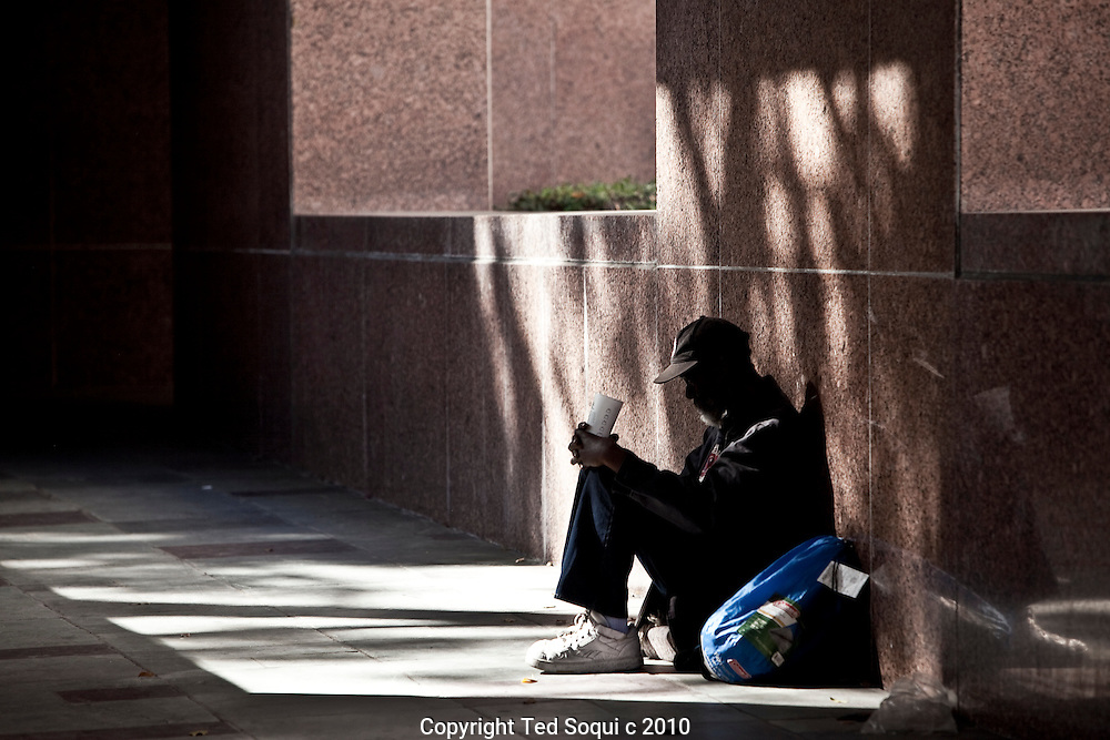 A homeless panhandler sits outside the L.A. Superior Courthouse..Downtown L.A. has the largest concentration of homeless people in the U.S.