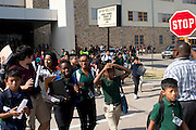 Students are released from Sam Tasby Middle School in Dallas, Texas on October 1, 2014. Officials confirmed that a student at Sam Tasby Middle School had come in contact with the first confirmed Ebola virus patient in the United States. (Cooper Neill for The New York Times)