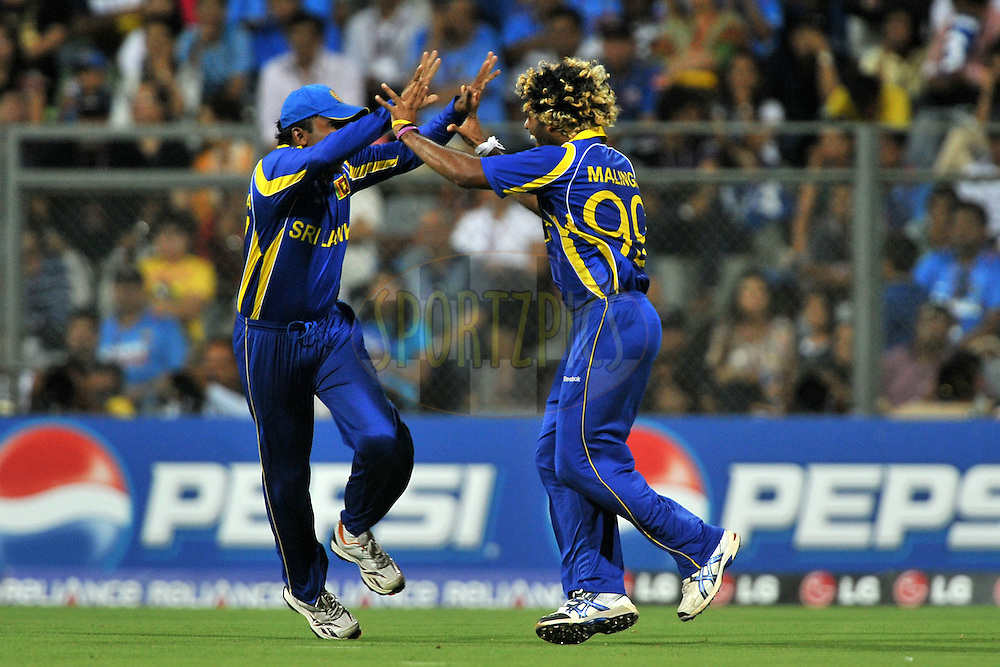 Lasith Malinga of Sri Lanka celebrate the wicket of Sachin Tendulkar of India during the ICC Cricket World Cup Final between India and Sri Lanka held at the Wankhede Stadium in Mumbai on the 2nd April 2011..Photo by Pal Pillai/BCCI/SPORTZPICS