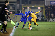 AFC Wimbledon midfielder Dean Parrett (18) battles for possesion with Sutton United midfielder Bedsente Gomis (8)during the The FA Cup third round replay match between AFC Wimbledon and Sutton United at the Cherry Red Records Stadium, Kingston, England on 17 January 2017. Photo by Matthew Redman.