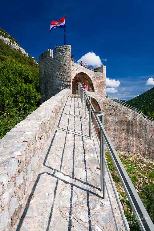 The Great Wall and Croatian flag on fortress, Ston, Dalmatian Coast, Croatia