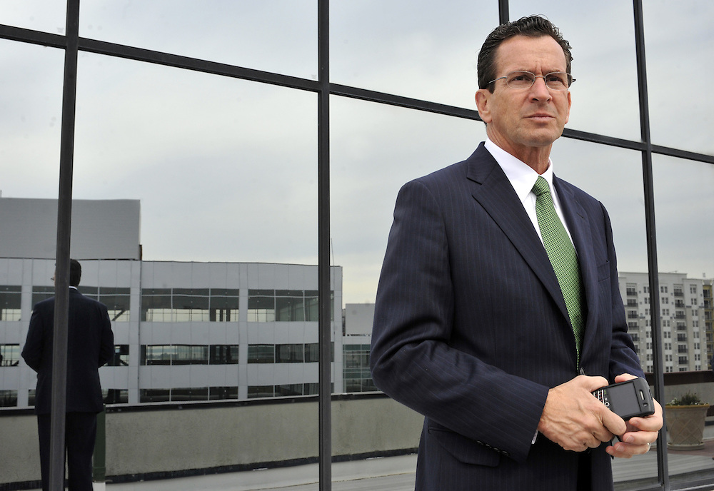 Governor-elect and former Stamford Mayor Dan Malloy looks out at new office buildings in the south end of the city of Stamford, Conn., a growing area of redevelopment.  (AP Photo/Jessica Hill)