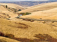 remote house along a highway climbing the Blue Mountain foothills in rural Garfield County, WA, USA.