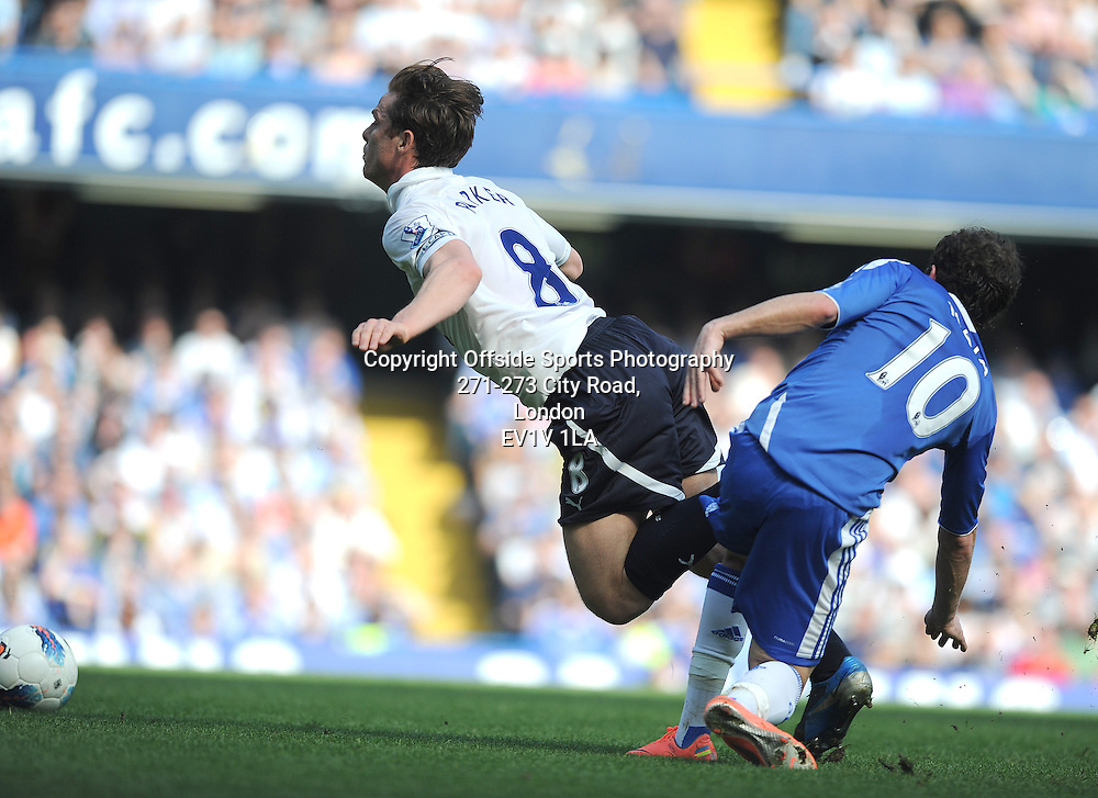 24/03/2012 - Barclays Premier League Football - 2011-2012 - Chelsea v Tottenham Hotspur - Scott Parker of Spurs is tripped by Juan Mata of Chelsea. - Photo: Charlie Crowhurst / Offside.
