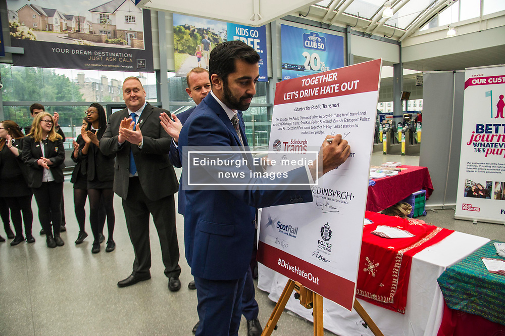Pictured: Mr Yousaf signs the pledge<br /> Humza Yousaf, MSP, minister for Transport and the Islands joined the Edinburgh Community Safety Partnership as they officially launched Edinburgh's Transport Charter aimed at eradicating hate crime on all forms of transport in the city. Each of the organisations involved with the partnership will outline their approach to responding to incidents.  The launch will be followed by two days of action where representatives will be in transport hubs, promoting an understanding of hate crime, raising awareness of the charter and how to report unacceptable behaviours. Charter Representatives: Transport and Environment Convener, Lesley Macinnes, Alex Hynes from the Scotrail Alliance, Michael Powell from Edinburgh Trams, Jason Hackett from First Buses, Superintendent Richard Horan from Police Scotland, Chief Inspector Sue Maxwell from British Transport Police and Transport Scotland. Allister McKillop Vice Chair of Equality Transport Advisory Group (ETAG) and representatives from the Access Panel, Hollaback, SCOREScotland, NKS, Edinburgh Women's Interfaith Group and SESTran along with students from Currie High School<br /> <br /> Ger Harley | EEm 27 June  2017