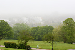 © Licensed to London News Pictures. 29/04/2019. London, UK. A woman walking her dog in Alexandra Palace park as early morning mist coats north London. Photo credit: Dinendra Haria/LNP