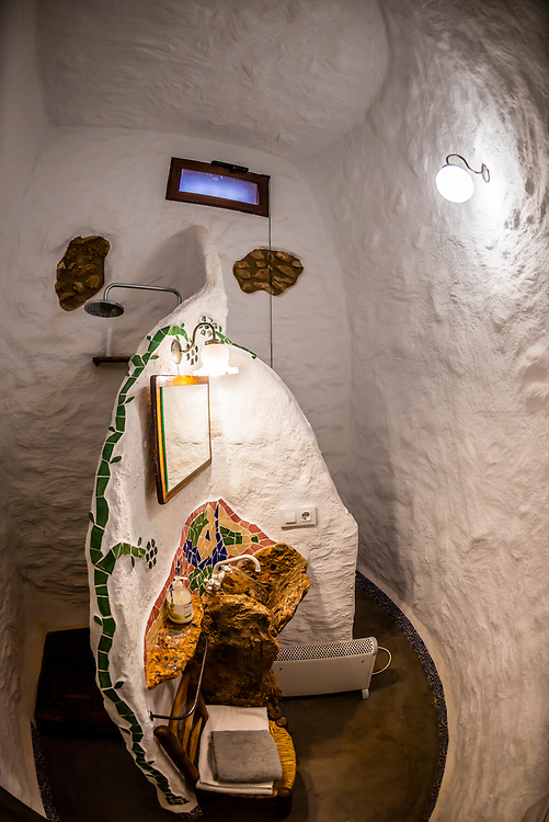 Interior view of shower in bathroom,  Balcones de Piedad, Los Balcones, near Guadix, Granada Province, Andalusia, Spain. Five cave apartments in this boutique hotel give visitors the opportunity to stay in a luxury suite built into a cave.