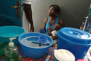 Ghana: 25 April 2012, Forgive Fiatsi, 21, listens to a nurse as she sits with her son Richmond, 1, in the ORS (oral rehydration salts) unit of the Princess Marie Louise Children's hospital in Accra..The GAVI Alliance is a public-private partnership that brings together developing country and donor governments, WHO, UNICEF, the World Bank, the vaccine industry in both industrialised and developing countries, research and technical agencies, civil society, the Bill & Melinda Gates Foundation and other private philanthropists.  Set up in 2000 as the Global Alliance for Vaccines and Immunisation, GAVI's mission is to save children's lives and protect people's health by increasing access to immunisation in the world's poorest countries.