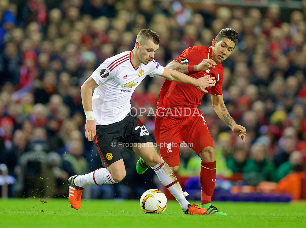 LIVERPOOL, ENGLAND - Thursday, March 10, 2016: Liverpool's Roberto Firmino in action against Manchester United's Morgan Schneiderlin during the UEFA Europa League Round of 16 1st Leg match at Anfield. (Pic by David Rawcliffe/Propaganda)