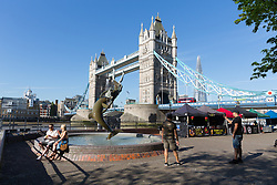 © Licensed to London News Pictures. 05/05/2018. London, UK. People enjoying the sunshine next to Tower Bridge during hot and sunny weather near the River Thames in London this morning. Photo credit: Vickie Flores/LNP