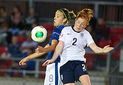 LLANELLI, WALES - Monday, August 19, 2013: England's Martha Harris in action against France's Clarisse Le Bihan during the Group A match of the UEFA Women's Under-19 Championship Wales 2013 tournament at Stebonheath Park. (Pic by David Rawcliffe/Propaganda)