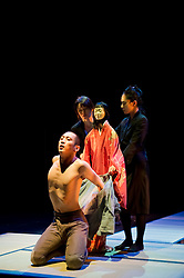 "© Copyright licensed to London News Pictures. 05/11/2010. Young Sasuke (Songha Cho) is in the mood for love as Shun-Kin (Puppeteers Eri Fukatsu, Junko Uchida, Yasuyo Mochizuki) approaches. Complicite present ""Shun-Kin"" at the Barbican, London. Directed by Simon McBurney, based on the writings of Jun'ichiro Tanizaki."