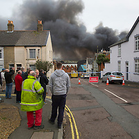 25 January 2016, News, Cowes, Isle of Wight, England, Large fire in former J Samuel White ship yard. Fire started in a garage unit, and rapidley spread to boat building and fabrication units. A fire has broken out at a workshop on an industrial estate on the Isle of Wight.<br /> <br /> Isle of Wight Fire and Rescue said more than 30 firefighters were tackling the blaze at Medina Village on Bridge Road in Cowes.<br /> <br /> Fifty fibreglass boats are believed to be on the premises as well as cars and acetylene cylinders. Large Fire, J Samuel Whites, Industrial Estate, Cowes, Isle of Wight, Large Fire, J Samuel Whites, Industrial Estate, Cowes, Isle of Wight, Large Fire, J Samuel Whites, Industrial Estate, Cowes, Isle of Wight, Large Fire, J Samuel Whites, Industrial Estate, Cowes, Isle of Wight, Large Fire, J Samuel Whites, Industrial Estate, Cowes, Isle of Wight,