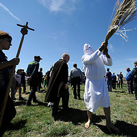 """A Picao penitent whips himself during the """"Santa Vera Cruz"""" brotherhood procession of the Holy Week in San Vicente de la Sonsierra, 330km north of Madrid, on April 18, 2014.   PHOTO/ RAFA RIVAS"""