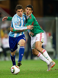 Gonzalo Higuain of Argentina vs Francisco Rodriguez of Mexico during the 2010 FIFA World Cup South Africa Round of Sixteen match between Argentina and Mexico at Soccer City Stadium on June 27, 2010 in Johannesburg, South Africa. (Photo by Vid Ponikvar / Sportida)