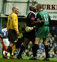 Photo: Ed Godden.<br /> Portsmouth v Arsenal. The Barclays Premiership. 12/04/2006. Dean Kiely (Pompey) is dragged away from Arsenals Freddie Ljungberg by the ref U. Rennie.