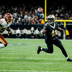 Nov 19, 2017; New Orleans, LA, USA; New Orleans Saints running back Alvin Kamara (41) makes a bobbling reception for a touchdown past Washington Redskins linebacker Martrell Spaight (50) during the second half of a game at the Mercedes-Benz Superdome. The Saints defeated the Redskins 34-31 in overtime. Mandatory Credit: Derick E. Hingle-USA TODAY Sports