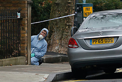 © Licensed to London News Pictures. 06/12/2016. London, UK. Police forensics at the scene of a murder in Fulham, where a 24 year old man was found with a gunshot wound to the head at 21:30hrs on Monday, 5 December. The man was pronounced dead at the scene. Photo credit : Tolga Akmen/LNP