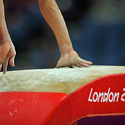 Jorge Hugo Giraldo Lopez of Columbia pushes off the vault apparatus during men's team preliminary competition at North Greenwich Arena during the 2012 Summer Olympic Games in London, England, Saturday, July 28, 2012. (David Eulitt/Kansas City Star/MCT)