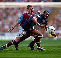 Photo. Richard Lane<br />Aton Villa v Arsenal. Barclaycard Premiership. 05/04/2003.<br />Patrick Vieira is brought down by Joey Gugjonsson
