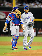 Sep. 27 2011; Phoenix, AZ, USA; Los Angeles Dodgers catcher Rod Barajas (28) and pitcher Hiroki Kuroda (18) talk on the field while playing against the Arizona Diamondbacks at Chase Field.  Mandatory Credit: Jennifer Stewart-US PRESSWIRE.