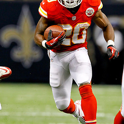 September 23, 2012; New Orleans, LA, USA; Kansas City Chiefs running back Shaun Draughn (20) runs against the New Orleans Saints during the second half of a game at the Mercedes-Benz Superdome. The Chiefs defeated the Saints 27-24 in overtime. Mandatory Credit: Derick E. Hingle-US PRESSWIRE