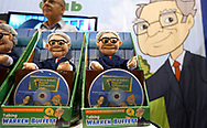 Dolls of Berkshire Hathaway CEO Warren Buffett and DVDs of a children's financial cartoon show Buffett did are on sale at the shareholder shopping day as part of the Berkshire Hathaway annual meeting weekend in Omaha, Nebraska May 5 2017. REUTERS/Rick Wilking