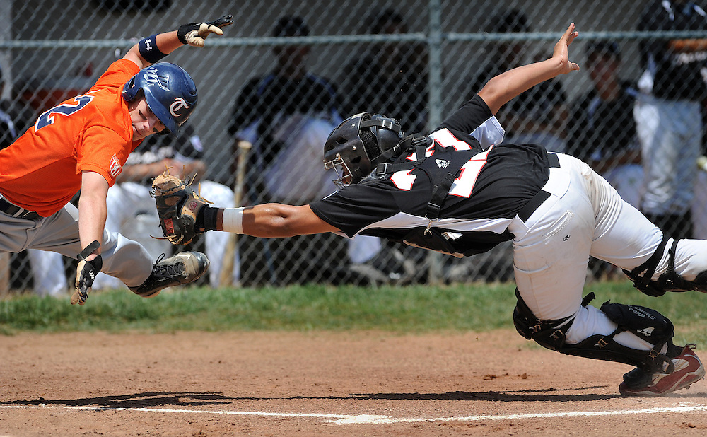 Antonio Frazio (right) of Forest tags out Graf Steven of the Long Island Tigers at home plate during their game.