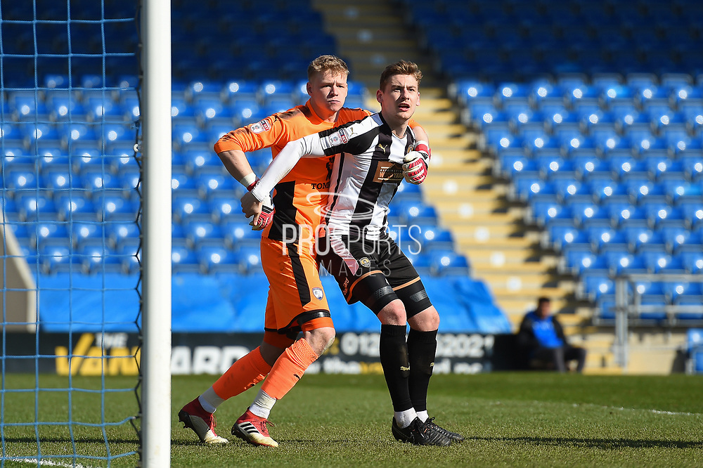 Chesterfield goalkeeper Aaron Ramsdale (1) and Notts County defender Elliott Hewitt (4) during the EFL Sky Bet League 2 match between Chesterfield and Notts County at the b2net stadium, Chesterfield, England on 25 March 2018. Picture by Jon Hobley.