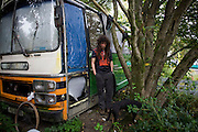 Activist 'Hoosie' aka Robert House stands outside his bus-turned-home early on a Sunday morning at the Faslane Peace Camp...