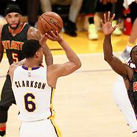 27 November 2016: Los Angeles Lakers guard Jordan Clarkson (6) takes a jump shot over Atlanta Hawks forward Taurean Prince (12) during the Los Angeles Lakers 109-94 victory over the Atlanta Hawks, at the Staples Center, Los Angeles, California, USA.