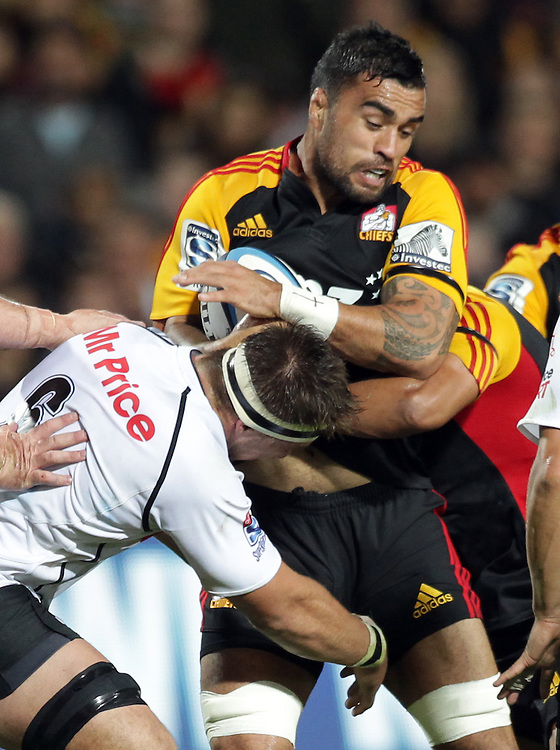 Chiefs' Liam Messam is tackled by Sharks' Derick Minnie in a Super Rugby match, Waikato Stadium, Hamilton, New Zealand, Saturday, April 27, 2013.  Credit:SNPA / David Rowland