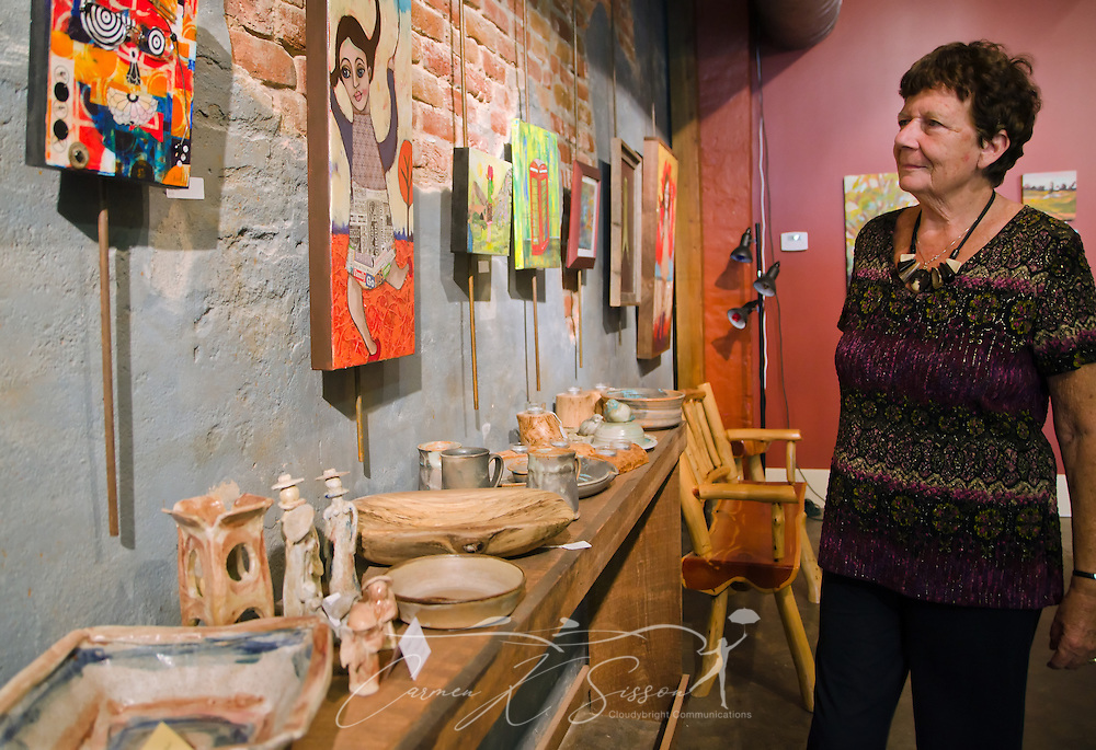 Artist Hanne Gaycken walks through Bozart's Gallery, where she is one of 15 artists who make up the Bozart's Alliance in Water Valley, Mississippi. (Photo by Carmen K. Sisson/Cloudybright)